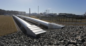 The terminating point of the Nord Stream Pipeline is located at the energy hub Lubminer Heide near Greifswald, which covers an area of about 12 hectares, including the receiving terminal of the connecting pipelines OPAL and NEL. The onshore part of Nord Stream's twin pipelines was built to include an omega-shaped expansion loop, capable of compensating for any possible pipeline expansion or contractions due to pressure and temperature variations. This is connected to huge valves, and the pipeline eventually ends in the PIG (Pipeline Inspection Gauges) trap. The arriving gas is fed into the receiving station of OPAL and NEL via a cross-connection. The gas is then prepared for further transport through the connecting pipelines.