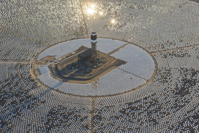 1's heliostast installation is nearly completed, and steam blow tests are taking place. Located in the Mojave Desert 40 miles southwest of Las Vegas, The Ivanpah Solar Power Facility is a solar thermal power project, currently under construction, with a planned capacity of 392 megawatts, enough to power approximately 140,000 houses. It will deploy 170,000 heliostat mirrors spread over 4,000 hectares, focusing solar energy on boilers located atop three solar power towers, generating steam to drive specially adapted steam turbines The project, developed by Bechtel, will cost $2.2 billion and be the largest solar farm in the world (photo Gilles Mingasson/Getty Images for Bechtel).
